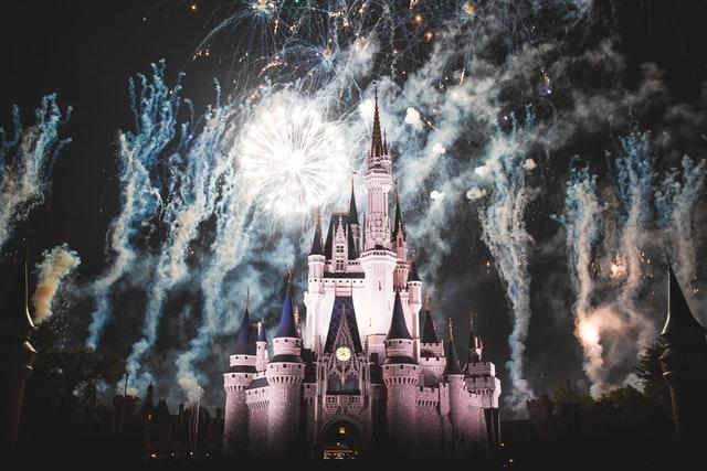 cinderella's castle lit up by fireworks